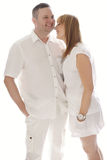 Very Happy Couple in White Outfit Royalty Free Stock Photography