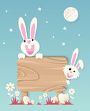 Very Happy Easter,bunny and eggs with wood sign Royalty Free Stock Photos