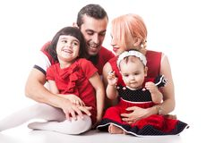 Very happy family of four members over white background Royalty Free Stock Image