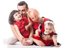 Very happy family of four members over white background Stock Image