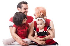 Very happy family of four members over white background Royalty Free Stock Photos