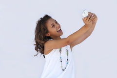 A very happy girl with cell phone. A girl looking at her cell phone with lots of personality royalty free stock images