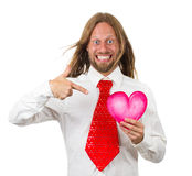 Very happy hippie man pointing to a love heart. Silly, funny portrait of a happy, smiling man in retro red tie pointing to a love heart isolated on white Stock Photos