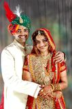 Very Happy Indian couple on their wedding day. Very Happy Indian (Asian) couple on their wedding day in their wedding dress (outfit). Joy of getting married. joy Stock Photo