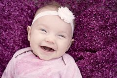Very Happy infant smiling at camera stock image