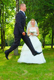 Very happy jumping bridegroom stock images