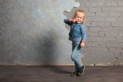 Very happy little girl dancing, jumping, smiling and posing. Cute toddler girl posing joyfully to camera. Dancing, jumping, running, laughing. Vintage background Royalty Free Stock Photos