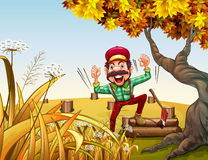 A very happy lumberjack beside the giant tree Royalty Free Stock Photo