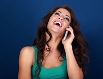 Very happy makeup laughing woman talking on mobile phone on brig Stock Photos