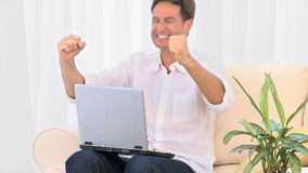 A very happy man with his laptop stock footage