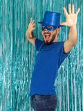 Very happy man is shouting and enjoying the party. Brazilian is. Bearded man is shouting and with his hands raised. Brazilian is wearing blue clothes: top hat Stock Photo