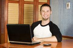 Very happy man sitting at computer. With big smile Stock Photos