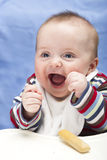 Very happy, messy 6 months old boy. Very excited 6 month old boy Royalty Free Stock Photography
