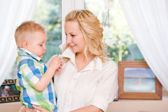 Very happy mom and son. Indoors portrait of a very happy mom and son together Stock Images