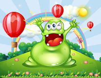 A very happy monster at the hilltop Royalty Free Stock Photo