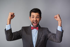 Very happy and positive casual young man Royalty Free Stock Photo