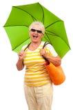 Very happy senior woman with sun umbrella Stock Photo