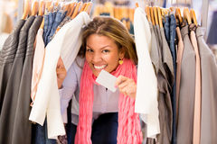 Shopping woman with a credit card Stock Photos