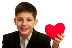 Very happy smiling boy holding red heart Stock Image