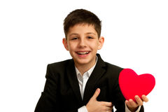 Very happy smiling boy is holding red heart Stock Photography