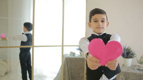 A very happy smiling boy is showing a red heart. valentines day, stock video footage