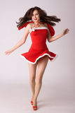 Very happy smiling woman in red xmas costume Stock Images