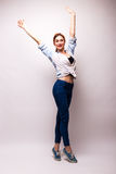 Very happy woman raising her arms and celebrating Royalty Free Stock Photo