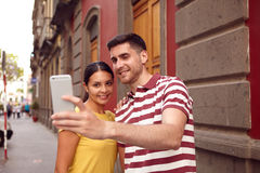 Very happy young couple taking a selfie Stock Images