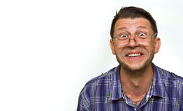 Very happy young man winning. Man looking at copyspace having a surprised or satisfied look isolated on white background Royalty Free Stock Photos