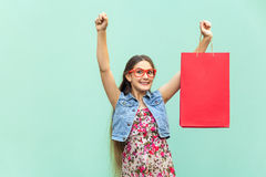 Very happyness beautiful long-haired girl in casual clothing with shopping bags, looking at camera. Caucasian blondie model. Stock Photography