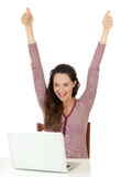 Very hapyy woman using a laptop. Portrait of a very happy beautiful woman looking at laptop and doing thumbs up Royalty Free Stock Photo