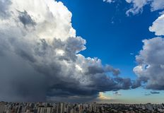 Very heavy rain sky in Sao Paulo city, Brazil South America. Beautiful view of dramatic dark stormy sky. The rain is coming soon. Pattern of the clouds over stock photos