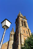 Very high belltower of cathedral in Dambach la Ville, France Royalty Free Stock Photos