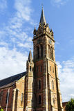 Very high belltower of cathedral in Dambach la Ville, France Stock Photography
