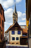 Very high belltower of cathedral in Dambach la Ville, France Stock Image