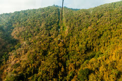 Very high glass mountain cableway seen from one cabin window Stock Image