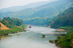 Very high mountains in Laos the river. Royalty Free Stock Photography