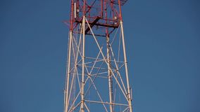 Very high radio tower with transmitting VHF and UHF equipment.