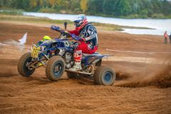 At very high speed. SERPUKHOV, RUSSIA - OCTOBER 7, 2017: Potaruev Aleksandr 757,  Class ATV, in the 4 stage  MX series, the Red Wings Cup 2017 super country Royalty Free Stock Image