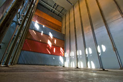 Very high stack of shipping containers loaded aboard container vessel. Royalty Free Stock Photo