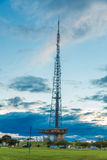 Very high telecommunication tower with blue sky and clouds in Brasilia, Brazil Stock Image