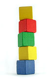 Very high tower. Colorful wooden cilds blocks stacked into a very high tower royalty free stock photography
