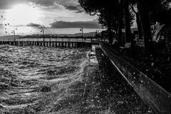 Very high water waves splashing on a lake shore, with drops comi Stock Image