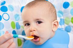 Very hungry baby child Stock Photography