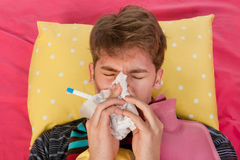 Very ill man is blowing his nose Royalty Free Stock Images