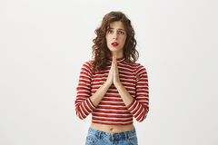 It is very important for me, please help. Charming caucasian girlfriend with taste of style, holding hands in pray and. Expressing anxiousness or worries while royalty free stock images
