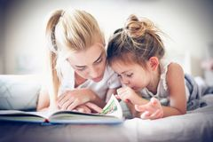 It is very important to educate your child. Lifestyle stock photography