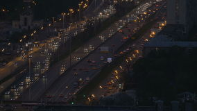 Very intense traffic on the streets of the city. In evening time. Wide road. View from a tall building. One road moves stock footage