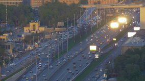 Very intense traffic on the streets of the city. In evening time. Wide road. View from the top point. stock footage