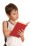 Very interesting book. A boy is reading very interesting book; isolated on the white background stock photos
